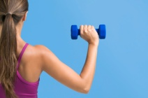 Woman-exercising-with-dumbbells